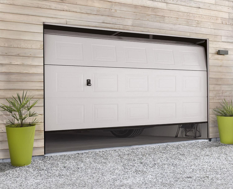 installation de porte de garage sectionnelle et mod les. Black Bedroom Furniture Sets. Home Design Ideas